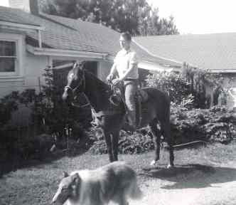 Hal on horse, with Laddie, Fort Bragg